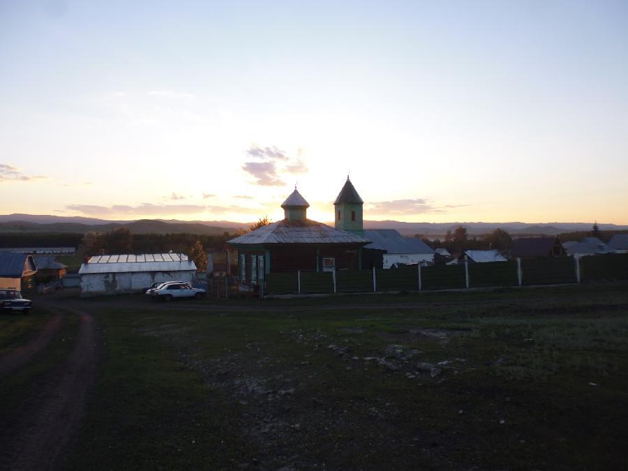 заход солнца и мечеть